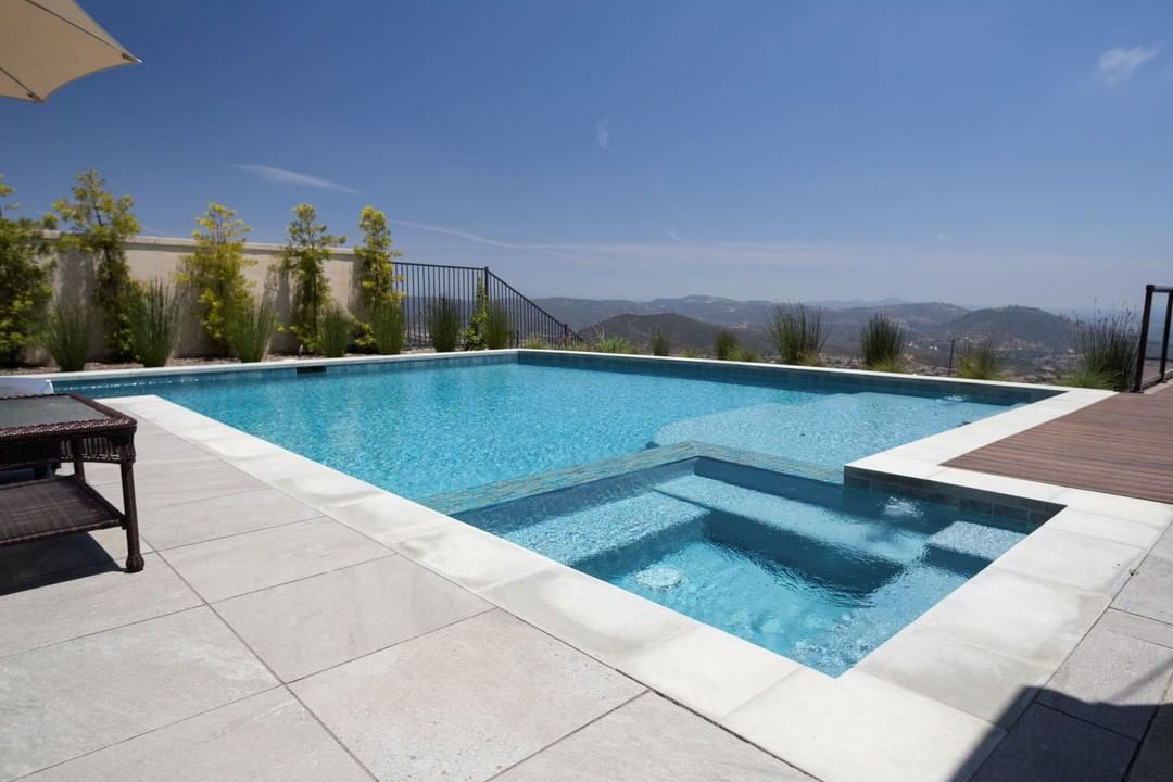 Geometric with concrete coping and combination concrete and wooden decking overlooking the mountains