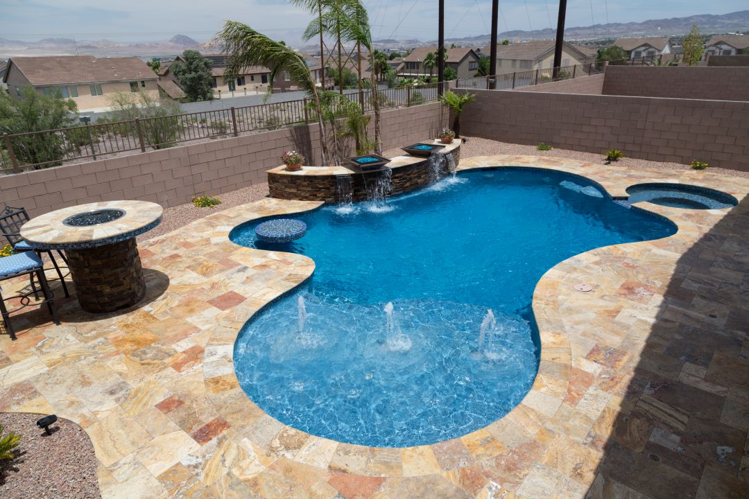 Nevada Freeform with bubbler trio, in-pool table, raised bond beam with fire bowls, and connected sp