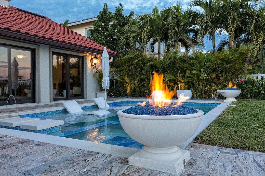 Luxurious Outdoor Pool with in Pool Seating & Firebowl on the Perimeter