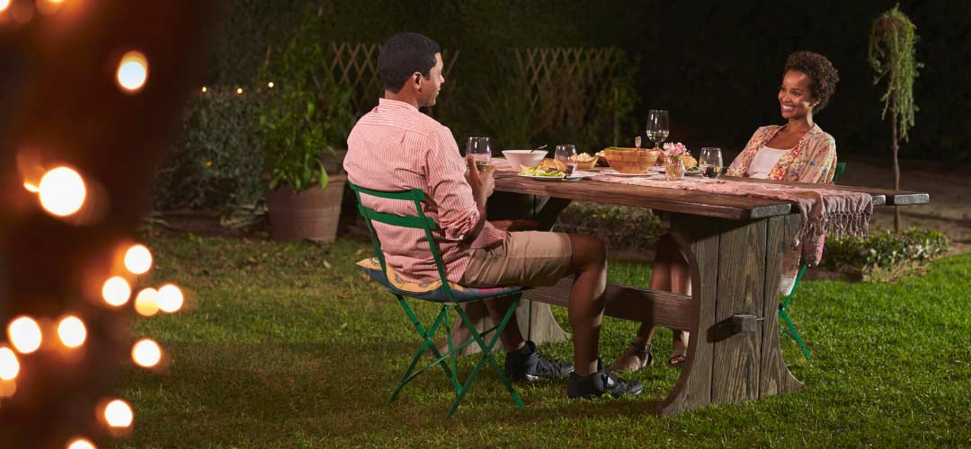 Couple Sitting at Outdoor Dining Table, Backyard Living