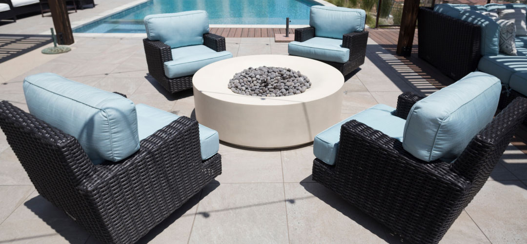 Cement Fire Pit with Stone & Blue Furniture