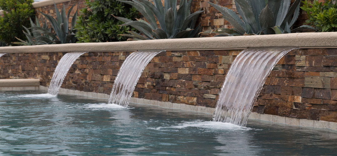 Water Features Cascade Into The Pool