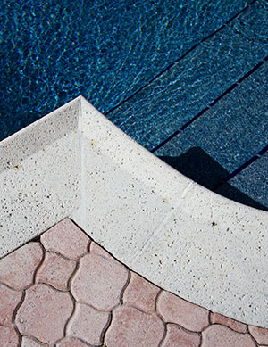 Classic – Rose Pink Concrete Pavers and Lite White Coping