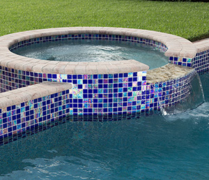Mermaid – Spa Lined in a Reflective Multicolor Tile with Cream Coping