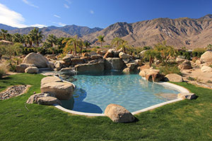 Natural – Bright Green Grass, Mountain Range View, Freeform Rocky Pool