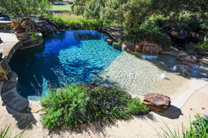 Natural – Beach Entry Pool, Bubblers, Greenery Surrounding Pool