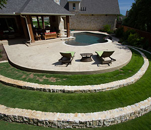 World – Circular Raised Patio, Steps are Grass Lines with Stone