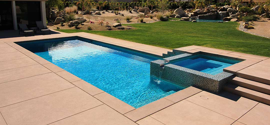 inground swimming pool with spa